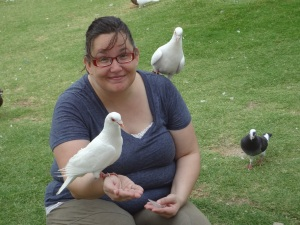 I was at the Iron Pagoda Park and stopped to feed the pigeons...yes rats with wings are climbing on me
