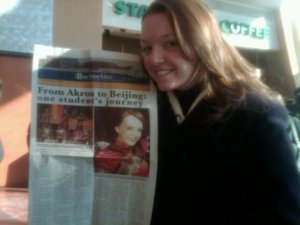 My partner in crime holding my first newspaper article at my university 2011